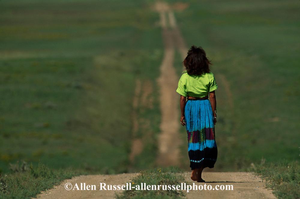 Woman walking down path, <br /> MODEL RELEASED