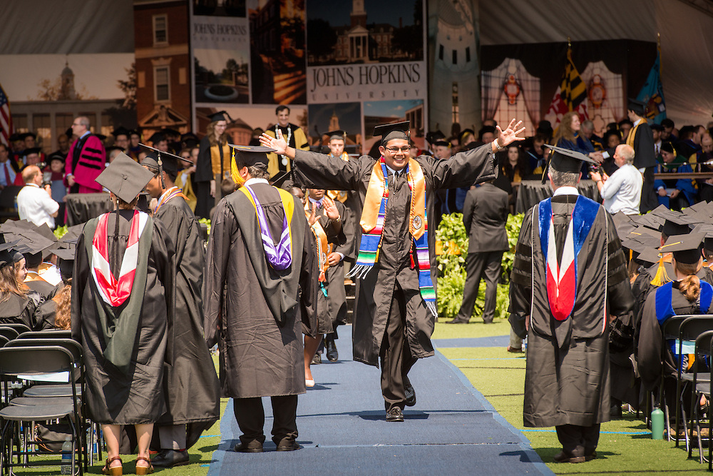 Excited graduate at graduation ceremony in Baltimore, Maryland, USA