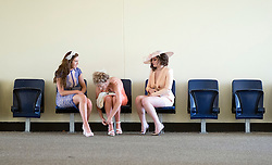 © Licensed to London News Pictures. 17/06/2014. Ascot, UK. Women rest and alter their outfits.  Day one at Royal Ascot 17th June 2014. Royal Ascot has established itself as a national institution and the centrepiece of the British social calendar as well as being a stage for the best racehorses in the world. Photo credit : Stephen Simpson/LNP