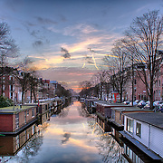 View of one of the Unesco world heritage famous city canals (gracht) of Amsterdam, The Netherlands.