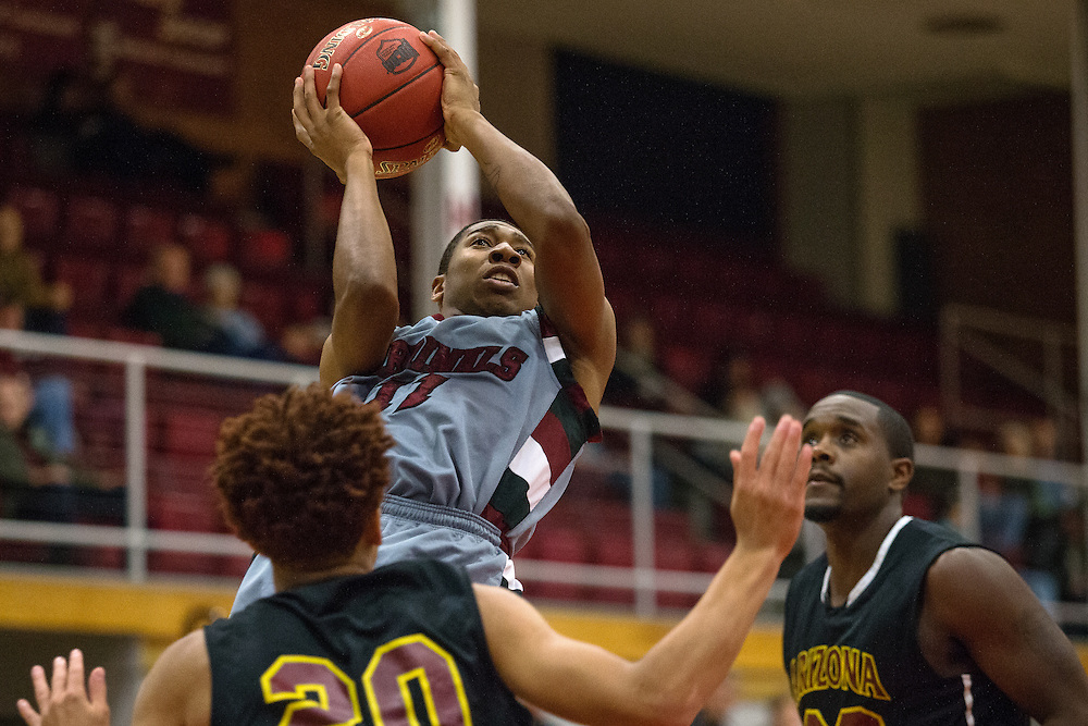 GABE GREEN/Press<br /> <br /> Freshman point guard for NIC, Will Dorsey rises above Arizona Western athletes, scoring two points for his team Saturday.