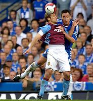 Photo: Daniel Hambury.<br />Chelsea v Aston Villa. The Barclays Premiership. 30/09/2006.<br />Chelsea's John Terry and Villa's Stilian Petrov battle.