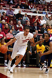 December 15, 2010; Stanford, CA, USA;  Stanford Cardinal guard Chris Barnum (32) dribbles past North Carolina A&T Aggies guard Marc Hill (10) during the first half at Maples Pavilion.