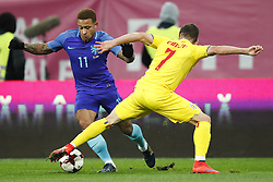 (l-r) Memphis Depay of Holland, Alexandru Chipciu of Romania during the friendly match between Romania and The Netherlands on November 14, 2017 at Arena National in Bucharest, Romania