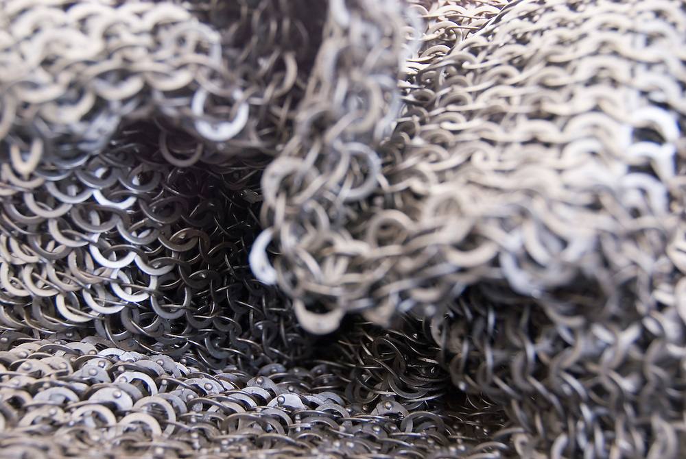 TEWKESBURY, GLOC. UK-12 JULY:  The surprising flexibility of chain mail in close up on 13 July 2014 at Tewkesbury Medieval Festival