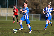 Fliss Gibbons runs with the ball during the FA Women's Sussex Challenge Cup semi-final match between Brighton Ladies and Hassocks Ladies FC at Culver Road, Lancing, United Kingdom on 15 February 2015. Photo by Geoff Penn.