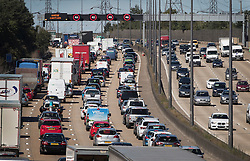 © Licensed to London News Pictures. 26/08/2016. Byfleet, UK. Traffic builds up northbound on the M25 as people leave for the bank holiday weekend. Photo credit: Peter Macdiarmid/LNP