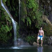 Hiker, Darren Moore, is admiring the beauty of Krause Springs in Spicewood, Texas.