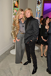 NICKY CLARKE and KELLY SIMPKIN at the Alexandra Shulman and Leon Max hosted opening of Vogue 100: A Century of Style at The National Portrait Gallery, London on 9th February 2016.