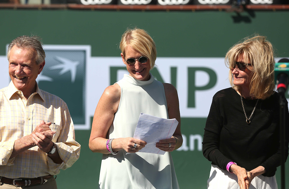 Vic Braden is honored during a ceremony on Stadium 1 at the 2015 BNP Paribas Open in Indian Wells, California on Thursday, March 19, 2015. From left: Ralph Braden,Kris Paul and Melody Braden.<br /> (Photo by Billie Weiss/BNP Paribas Open)
