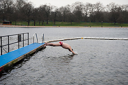 Members of the Serpentine Swimming Club brave the cold for an early morning swim...Robin Hunter, London, UK, 25 March, 2013. Photo by: i-Images..