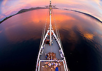 A fisheye sunset view from the crows' nest of traditional Indonesian charter boat. Travel photographer: Djuna Ivereigh.