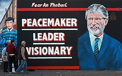 Young boys pose in front of a new mural of Gerry Adams which appeared on the Falls Road, west Belfast, Northern Ireland, on Friday, 2nd May 2014. Picture by i-Images