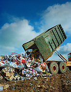 Dumping unused Walkers crisp packaging into a landfill site.