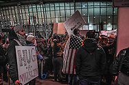 "Protesters holds sign saying, ""Hug a Muslim"" at an Anti-Trump rally at John F Kennedy Interational Airport, after the Trump administration implemented a ban on entry to citizens of 7 Muslim-majority nations into the United States.  New York, New York, USA.  28 January 2017"