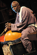 """Hamma Sankare master """"calebasse"""" player. The """"Calebasse"""" is the French word for pumpkin, species used as percussion instrument in Western Africa."""