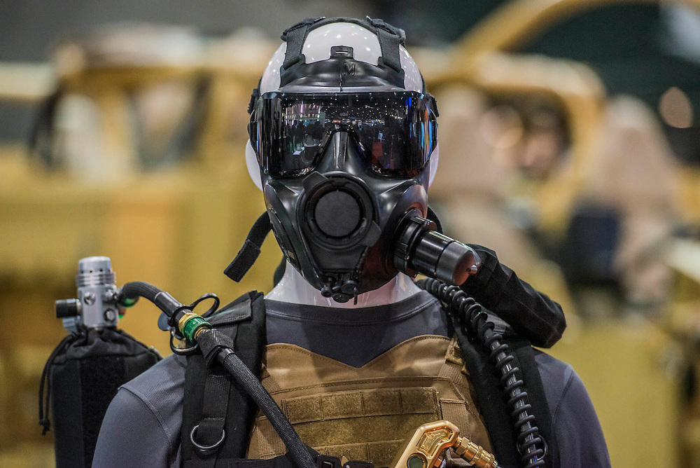 TThe Avon gas mask stand - he DSEI (Defence and Security Equipment International) exhibition at the Excel Centre, Docklands, London UK 15 Sept 2015