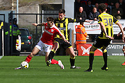 Barnsley midfielder Josh Brownhill uses his strength to shield the ball from Burton Albion midfielder Calum Butcher during the Sky Bet League 1 match between Burton Albion and Barnsley at the Pirelli Stadium, Burton upon Trent, England on 16 April 2016. Photo by Aaron  Lupton.
