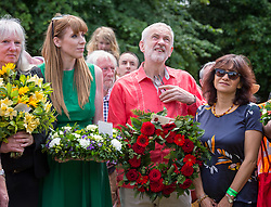 © Licensed to London News Pictures. 21/07/2019; Tolpuddle, Dorset, UK. JEREMY CORBYN leader of the Labour Party and his wife LAURA ALVAREZ (R) stand with ANGELA RAYNER MP (L) during a wreath laying ceremony at the grave of Tolpuddle Martyr James Hammett at the church in the village of Tolpuddle, part of the Tolpuddle Martyrs Festival. The Tolpuddle Martyrs Festival for trade unionism, held every year, commemorates the birth of the trade union movement in the 19th century when the Tolpuddle Martyrs were transported to Australia for forming a trade union of agricultural labourers in Dorset. Photo credit: Simon Chapman/LNP.