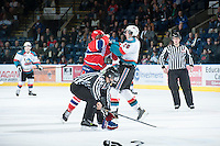 KELOWNA, CANADA - JANUARY 16:  Cole Linaker #26 of the Kelowna Rockets drops the gloves with a member of the Spokane Chiefs at the Kelowna Rockets on January 16, 2013 at Prospera Place in Kelowna, British Columbia, Canada (Photo by Marissa Baecker/Shoot the Breeze) *** Local Caption ***