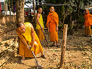 07 APRIL 2013 - CHIANG MAI, CHIANG MAI, THAILAND:  Novices do clean up work on the grounds of Wat Jetlin in Chiang Mai, Thailand. Chiang Mai is the largest town in northern Thailand and is popular with tourists and backpackers.       PHOTO BY JACK KURTZ