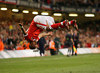 Photo: Rich Eaton.<br /> <br /> Wales v Cyprus. UEFA European Championships 2008 Qualifying. 11/10/2006. Robert Earnshaw of Wales celebrates in his customary style after scoring the second goal of the game for Wales