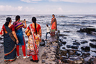 People at the Haji Ali Tomb in Mumbai.<br /> <br /> The Haji Ali Dargah is a mosque and dargah (tomb) located on an islet off the coast of Worli in the southern part of Mumbai. It is built on a tiny islet located 500 meters from the coast.