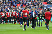 Manchester United Manager Louis van Gaal congratulates Michael Carrick during the The FA Cup semi final match between Everton and Manchester United at Wembley Stadium, London, England on 23 April 2016. Photo by Phil Duncan.