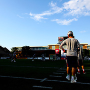 A member of the Boston Cannons watches his team warm up prior to the game at Harvard Stadium on August 9, 2014 in Boston, Massachusetts. (Photo by Elan Kawesch)