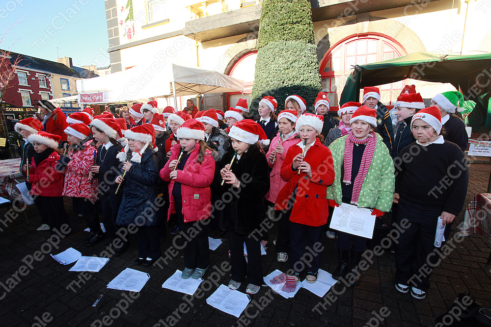 Student from Gaelscoil Ui Choinin carol singing in Kilrush on Thursday.<br /> Photograph by Yvonne Vaughan