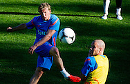 Dutch international football player Dirk Kuyt shoots the ball and Ron Vlaar  during the training for the trainingcamp of the Netherlands national football team in Hoenderloo on May 28, 2012. AFP PHOTO/ ROBIN UTRECHT