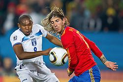 21-06-2010 VOETBAL: FIFA WORLDCUP 2010 SPANJE - HONDURAS: JOHANNESBURG <br /> Wilson Palacios of Honduras vs Sergio Ramos  of Spain<br /> ©2010-FRH- NPH/ Vid Ponikva (Netherlands only)