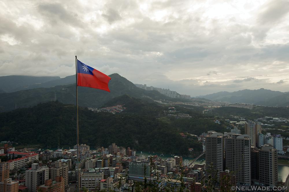 A Taiwan flag waves in the breeze in Taipei, Taiwan.