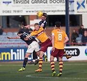 24th February 2018, Dens Park, Dundee, Scotland; Scottish Premier League football, Dundee versus Motherwell; Mark O'Hara of Dundee outjumps Andy Rose of Motherwell