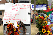Flower arrangements and a sign annoucing a blood donation drive are left at the site of the shooting at the First Baptist Church of Sutherland Springs, Texas, U.S. November 8, 2017.  REUTERS/Rick Wilking
