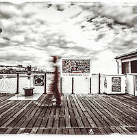 Where: Brighton pier, Britain.<br /> This grungy shot really gives us a feel of the weather.