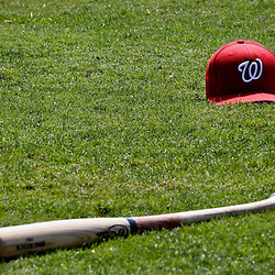 March 24, 2012; Sarasota, FL, USA; A detailed view of a Washington Nationals cap and bat on the field before a spring training game against the Baltimore Orioles at Ed Smith Stadium.  Mandatory Credit: Derick E. Hingle-US PRESSWIRE