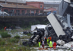 Emergency services on the scene where a motorway bridge collapsed in Genoa, Italy