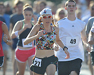 Female winner Sheryl Chatfield (27) runs at the starting line at the Stars and Stripes 5K in Oxford, Miss. on Monday, July 4, 2011.