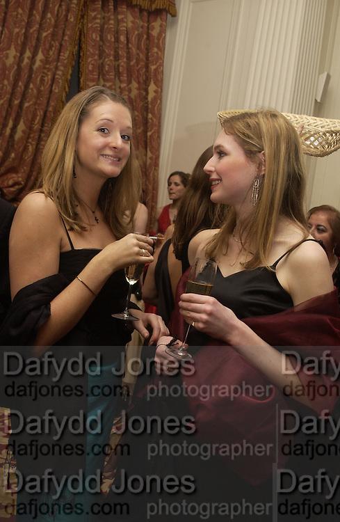 Clare Marshall and Arabella Stewart Purdy. Bulgari/NSPCC Snow Ball, Mandarin Oriental. 11 December 2002. © Copyright Photograph by Dafydd Jones 66 Stockwell Park Rd. London SW9 0DA Tel 020 7733 0108 www.dafjones.com