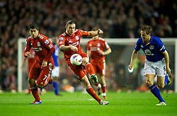 LIVERPOOL, ENGLAND - Tuesday, March 13, 2012: Liverpool's Andy Carroll and Luis Alberto Suarez Diaz in action against Everton's captain Phil Jagielka during the Premiership match at Anfield. (Pic by David Rawcliffe/Propaganda)