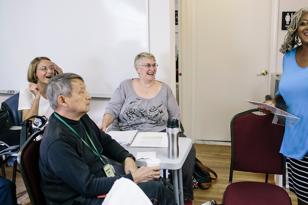 9/22/2014. FAIRFAX, VIRGINIA. Wendy Campbell talks with classmates to decide a scene to act out during OLLI player workshop drama class at Osher Lifelong Learning Institute in Fairfax, Va. Campbell, a former teacher, has found a new passion for acting through these classes.