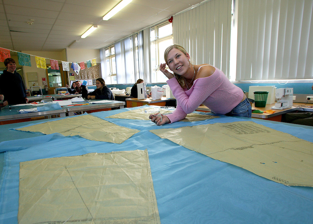 A fashion and design student cuts out her fabric at Spotswood College, New Plymouth, New Zealand, June 11, 2004. Credit:NSNPA / Rob Tucker