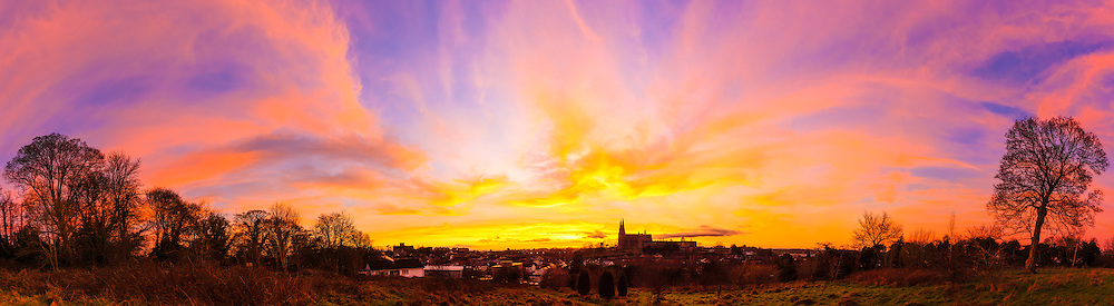 Last night's sunset over Armagh was truly astonishing and one of those that gave the full variety of fascinating colours as dusk gave way to nightfall.<br /> <br /> I ended up spending around 45 minutes out there taking photos as the conditions changed minute by minute and ended up with 219 photos that went into 30 panoramas!<br /> <br /> This one was taken around 15 minutes after the sun set when the pinks were dominating the sky.<br /> <br /> Image composed of 11 photos at 18mm offering a ~270 degree field of view including my favourite tree on the right-hand side.<br /> <br /> Available in sizes ranging from 8&quot;x28&quot; - 20&quot;x70&quot; (20cmx70cm - 51cmx178cm)