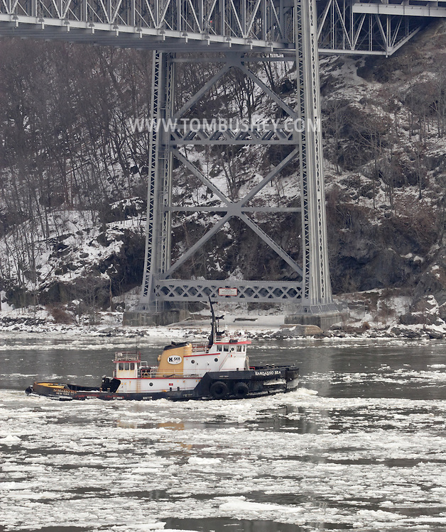 Bear Mountain, New York = The tugboat Sargasso Sea passes under the Bear Mountain Bridge while heading south on the Hudson River on  Feb. 20, 2007.