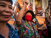 19 SEPTEMBER 2015 - BANGKOK, THAILAND:  Anti coup protestors gather at Democracy Monument in Bangkok. Hundreds of people protested against Thailand's military dominated government Saturday. The protest started with seminar about the 2006 coup that deposed popularly elected former Prime Minister Thaksin Shinawatra. After the seminar activists marched from Thammasat University to Democracy Monument, about 1 mile. Political gatherings of more than 5 people are banned by Thailand's military government and police tried to dissuade the protestors from finishing their march. Protestors ignored the police, who then stood by and watched but made no effort to intervene. At Democracy Monument protestors laid flowers and made speeches against the military. It was the largest anti-coup protest in Bangkok in more than a year.    PHOTO BY JACK KURTZ