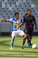 CAPE TOWN, South Africa - Monday 21 January 2013, Levent Gulen of Grasshopper Club Zurich challenges Amein Lebyane of Jomo Cosmos during the soccer/football match Grasshopper Club Zurich (Switzerland) and Jomo Cosmos at the Cape Town stadium..Photo by Roger Sedres/ImageSA