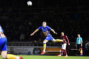 Shrewsbury Town midfielder Bryn Morris (16) heads the ball during the EFL Sky Bet League 1 match between Northampton Town and Shrewsbury Town at Sixfields Stadium, Northampton, England on 20 March 2018. Picture by Dennis Goodwin.