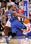 Orlando Magic point guard Jameer Nelson (14) runs into Utah Jazz power forward Paul Millsap during the second half of an NBA basketball game in Salt Lake City, Friday Dec. 10, 2010. the Jazz defeated the Magic 117-105. (AP Photo/Colin E Braley)