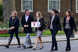© Licensed to London News Pictures. 16/09/2013. London, UK. Paula Barrow (C), a 45 year old mother of two from Manchester, leads a group of mothers; Beverley Muir (L), Nicole Elias (2R), Katherine Stipala (R) and Peter Saunders, the chief executive of the National Association for People Abused in Childhood (NAPAC) to Number 10 Downing Street in London today (16/09/2013) to deliver a petition calling for a 'Daniel's Law. The petition, which is still open and gathering signatures, asks for a law calling for the mandatory reporting of suspected child abuse by those working with children and is named in the memory of Daniel Pelka, a four year old who starved and beaten for months before he died. Photo credit: Matt Cetti-Roberts/LNP